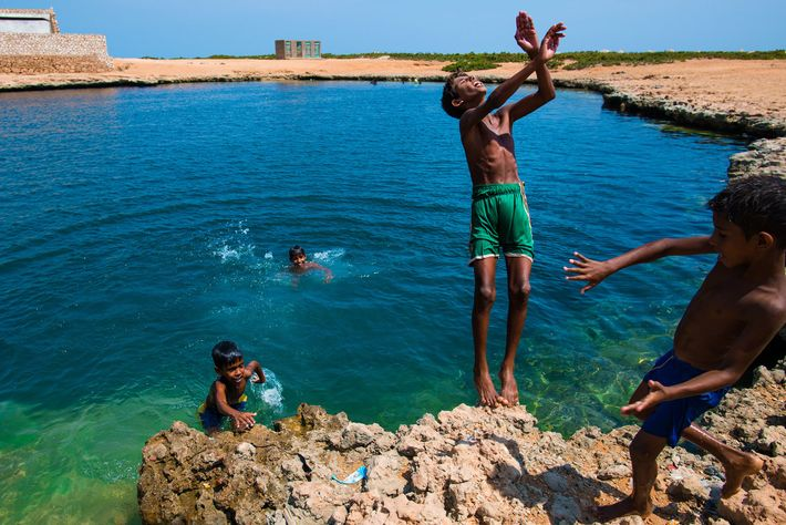 Protected by distance from the civil war that wracks the Yemeni mainland, Socotran kids play in ...