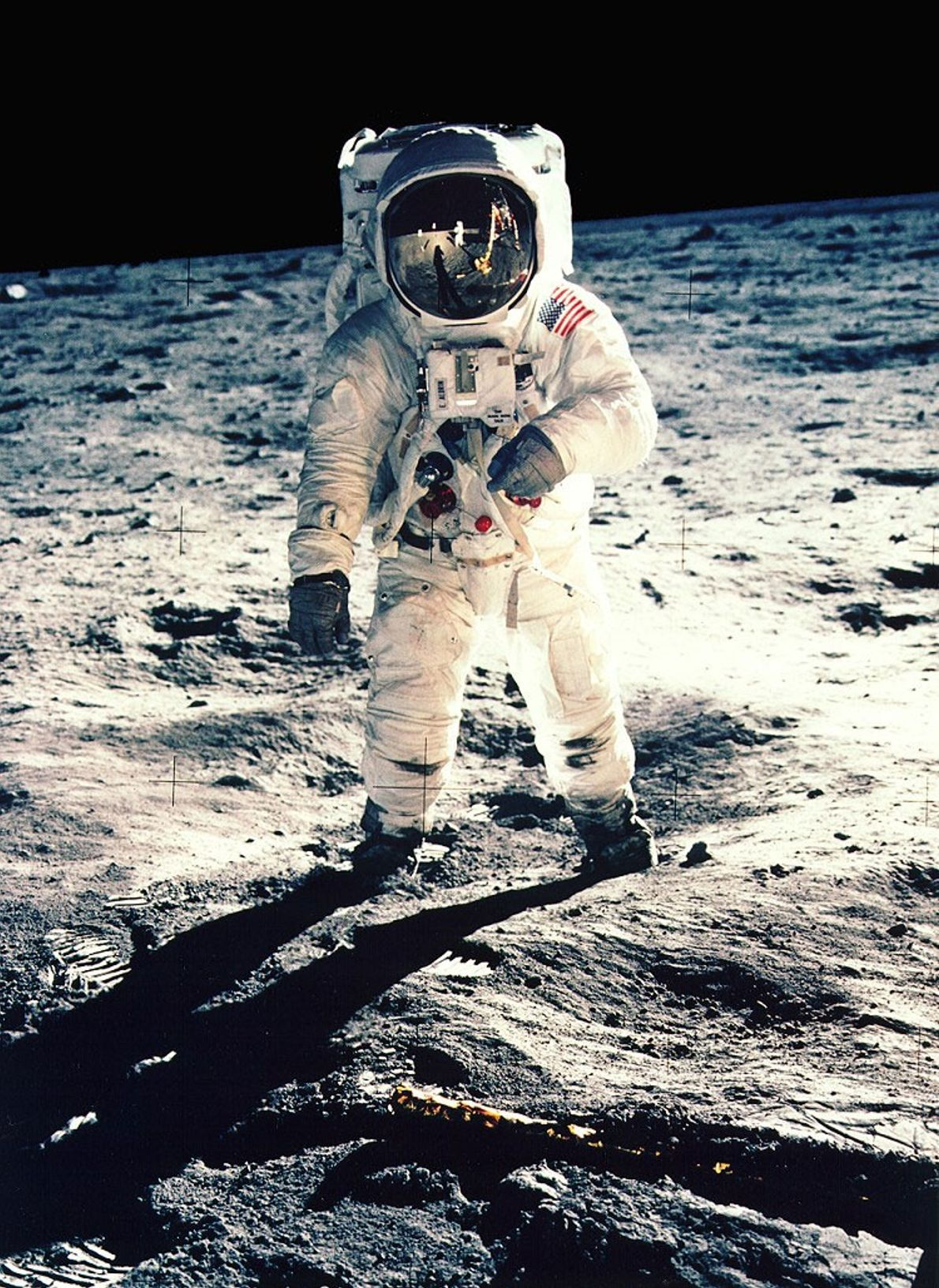 """Astronaut Neil Armstrong took this selfie, visible in the helmet of astronaut Edwin """"Buzz"""" Aldrin, during ..."""