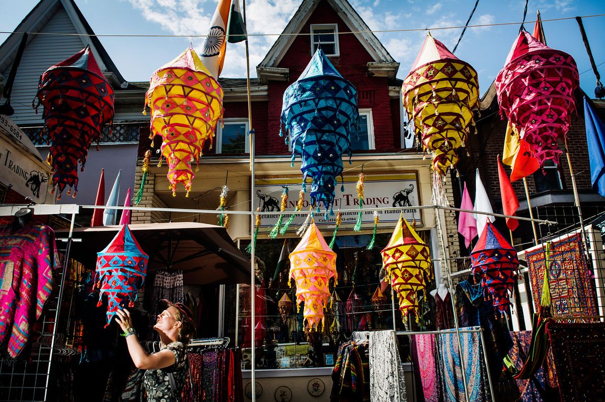 Browse the many culturally diverse shops and stalls in Kensington Market.