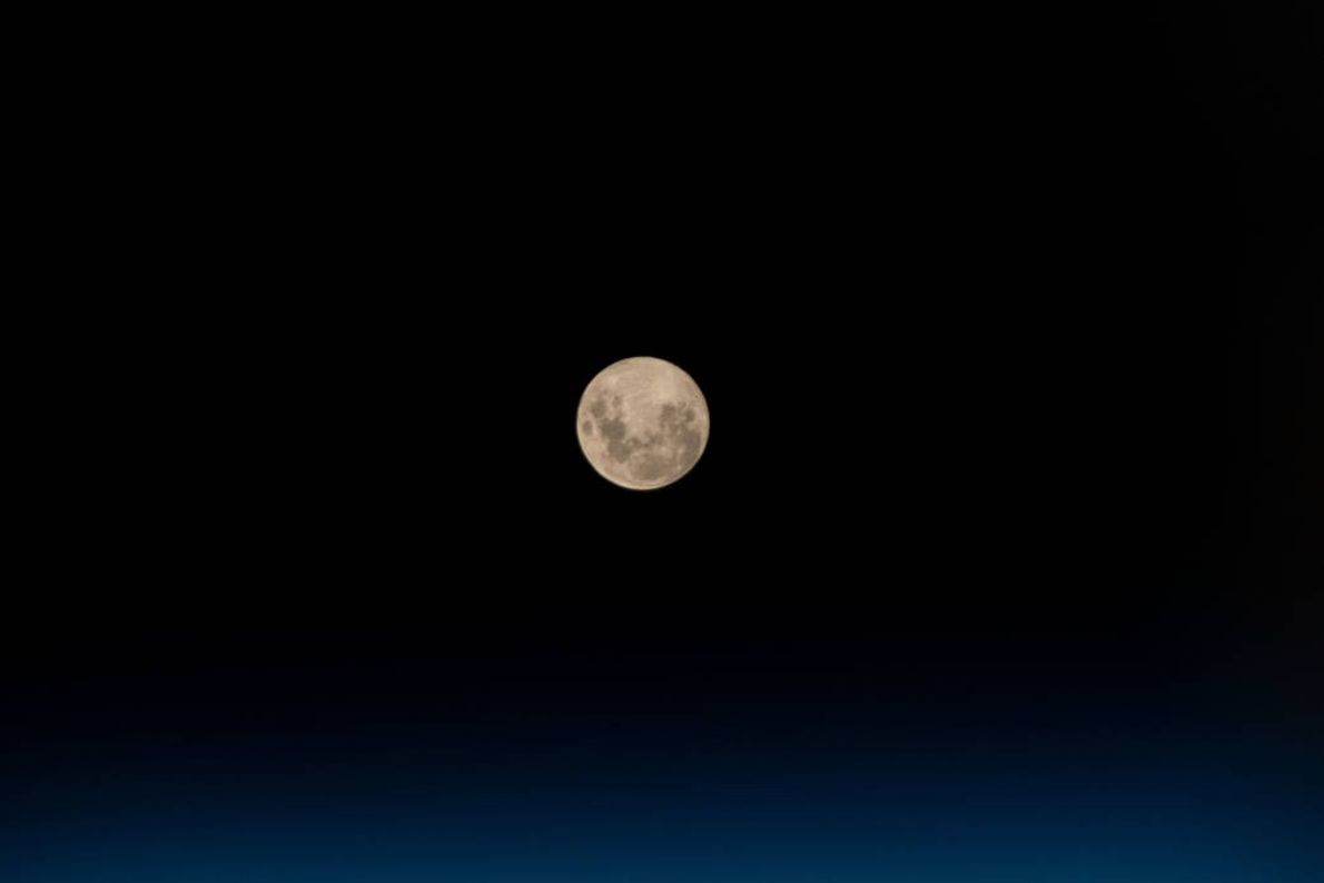 On May 18, the crew aboard the International Space Station took in the full moon as ...