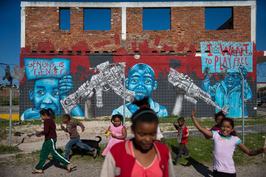 Children in the gang-ridden neighbourhood of Manenberg, Cape Town, South Africa play in front of a ...