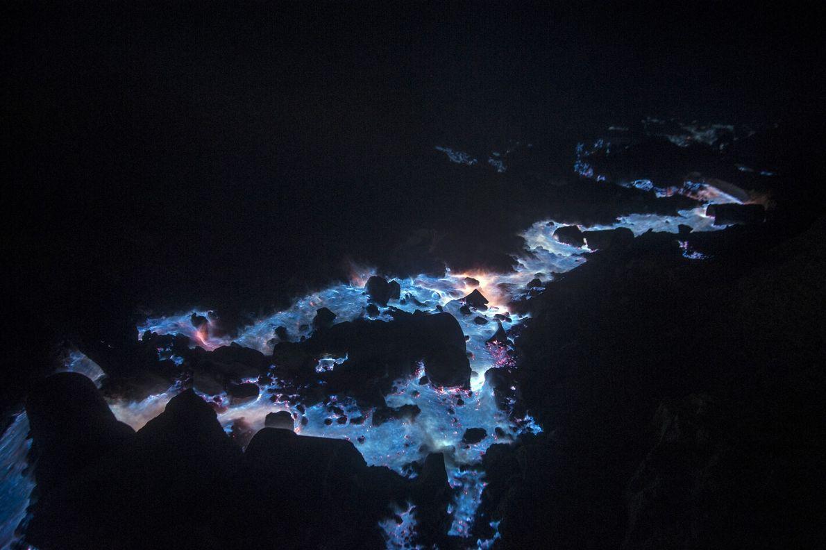 Ignited sulphur gas flows on the Kawah Ijen volcano in East Java, Indonesia.