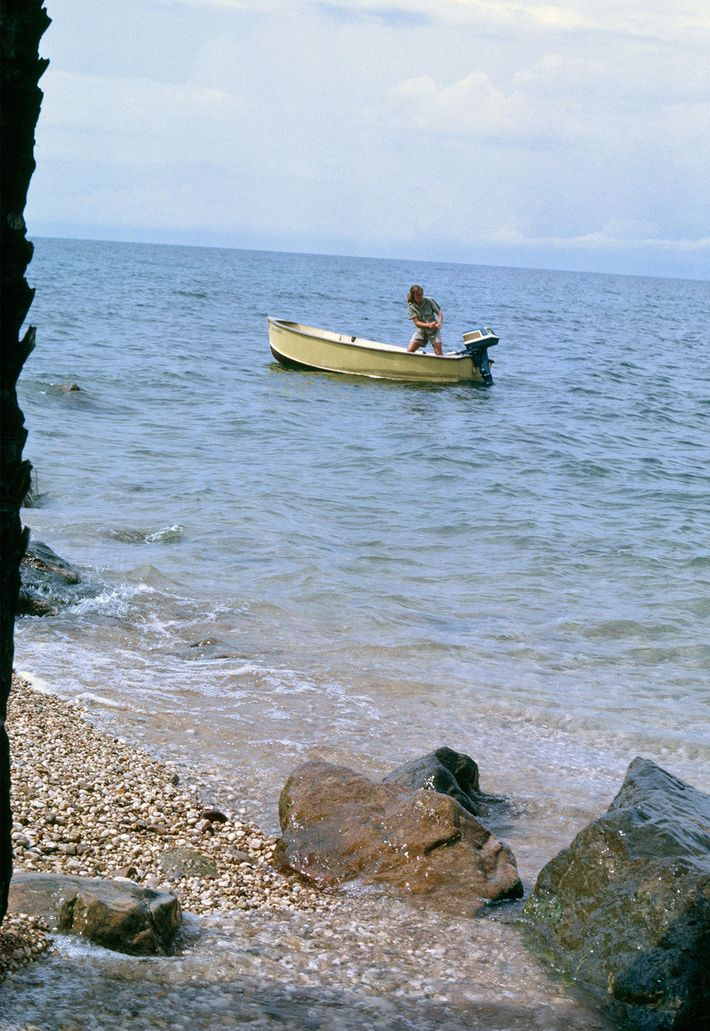 Balky outboard plagues the author on 420-mile-long Lake Tanganyika, her only route back to civilization. Storms ...