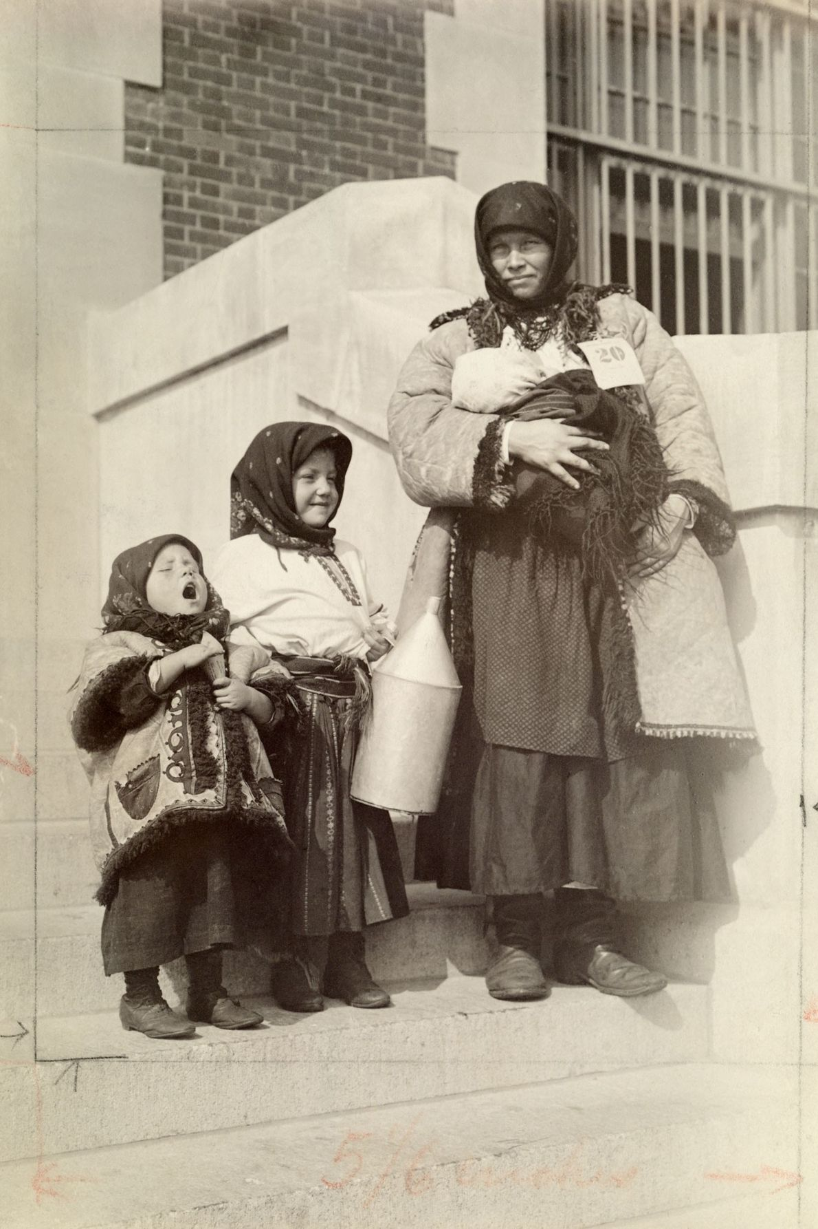 A Russian immigrant to the United States stands with her three children.