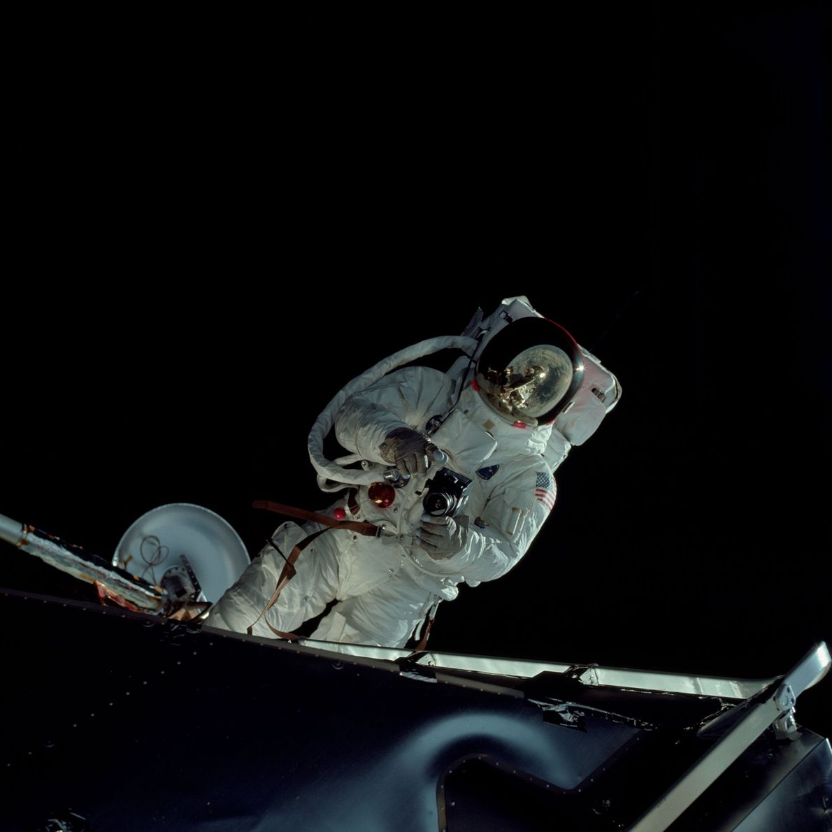 Rusty Schweichart holds a 70-millimetre Hassleblad camera during the Apollo 9 mission.