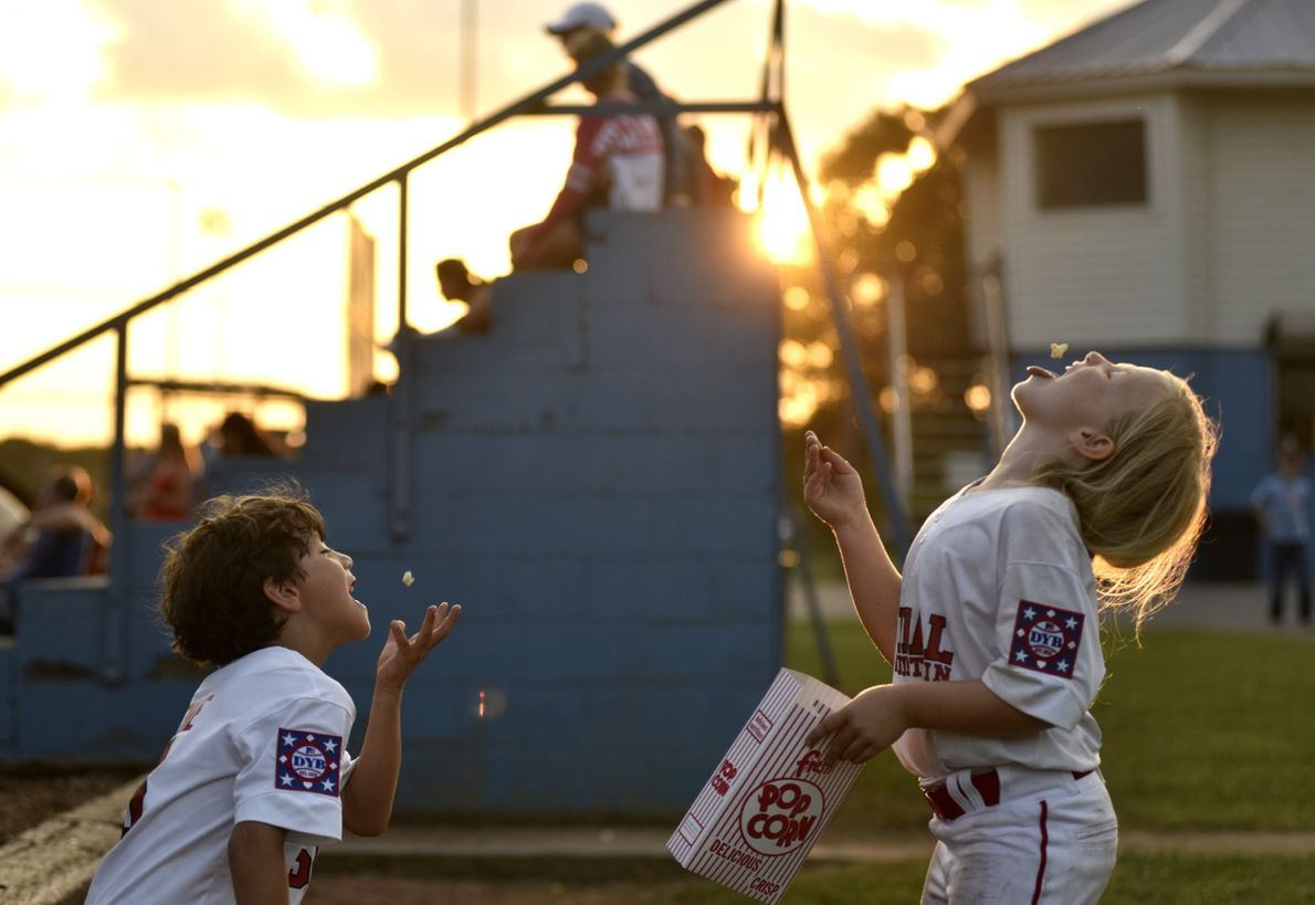 """Nico Devine and Madeline Ray Greeson share a snack after their baseball game in Chattanooga, Tennessee,"" ..."