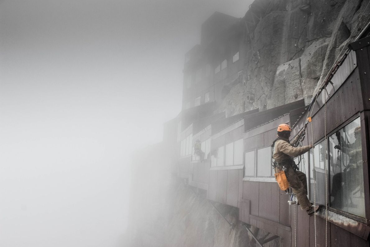 """""""A man washes windows of an installation at the top of the Aiguille du Midi in ..."""