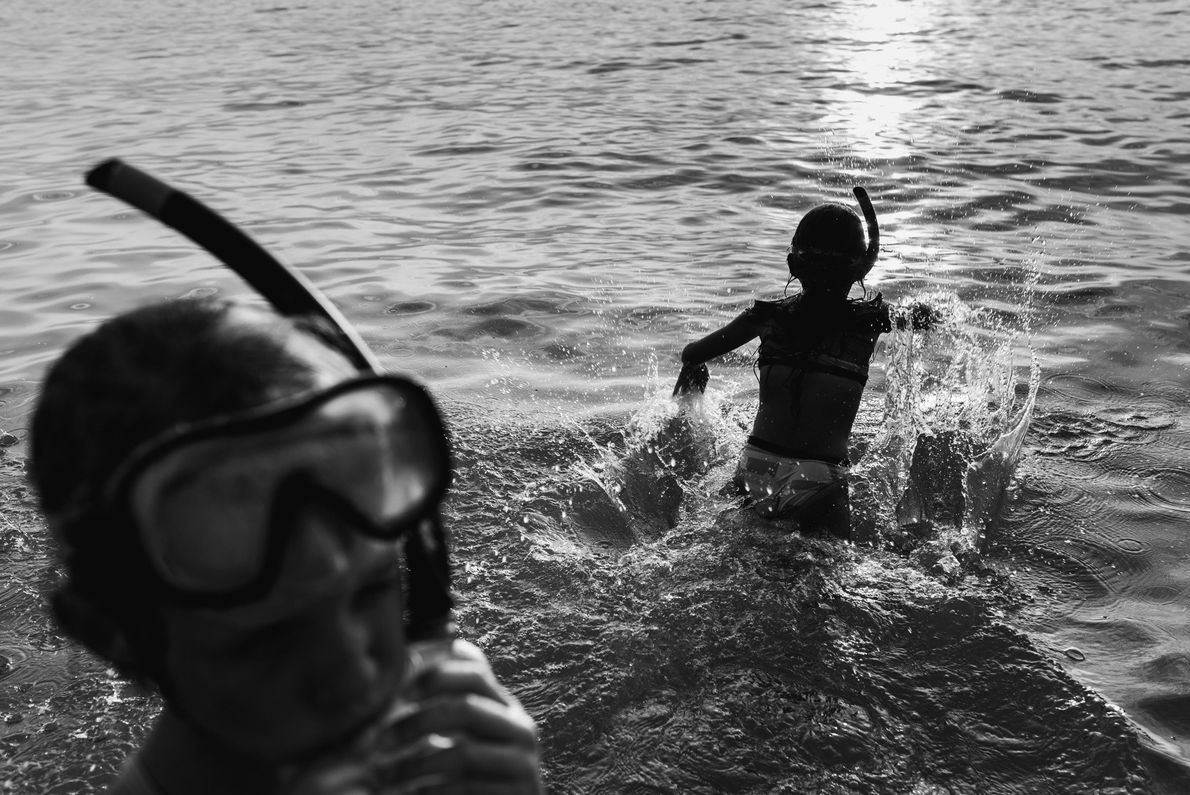 Your Shot photographer Joanna Milcarz documented her daughters as they swim at a lake during their ...