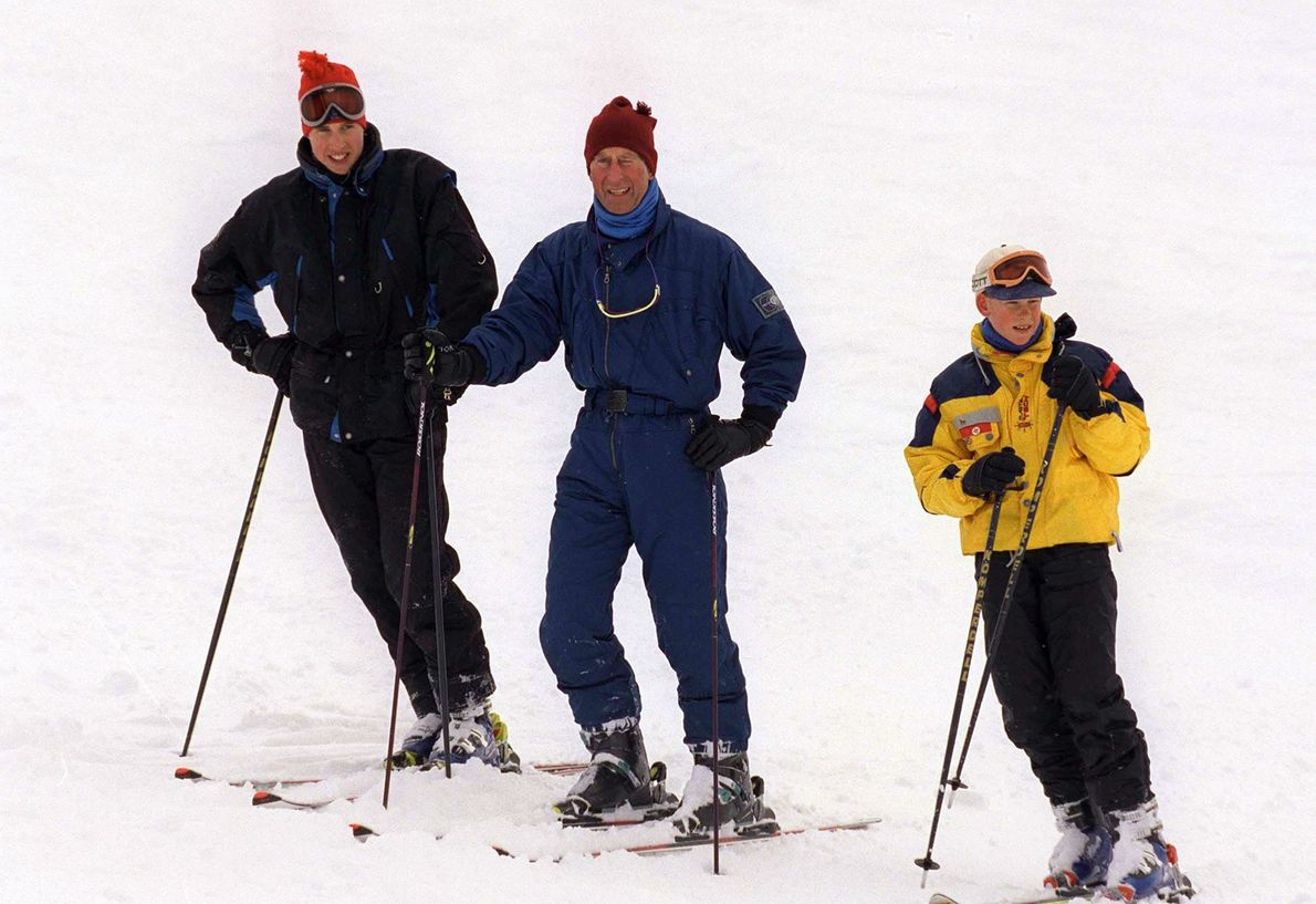 Prince Charles rests on the slopes with Princes William and Harry during a ski holiday in ...