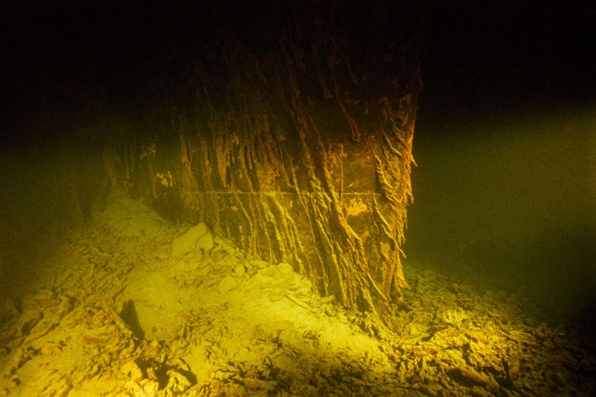 The ship's lower prow, which once cut through the ocean, is now embedded in mud on ...