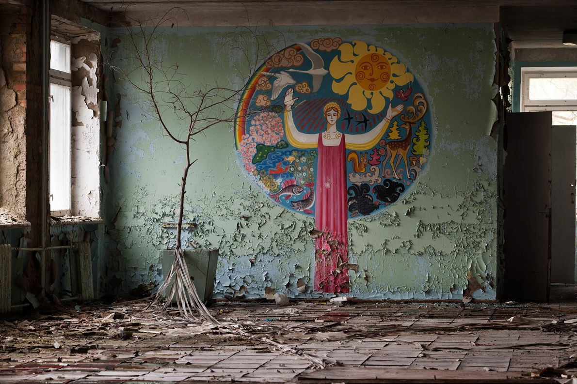 2005. A peeling mural of an abandoned school creates a poignant reminder of the residents that ...