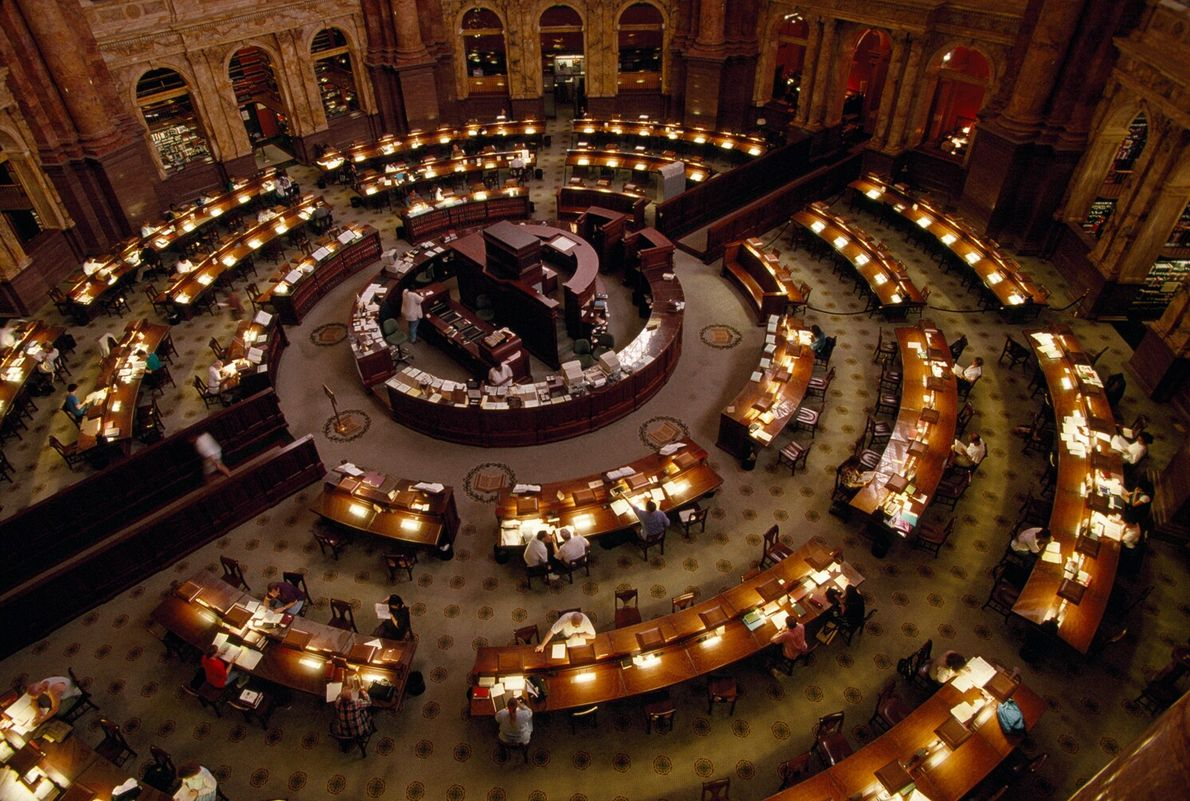 Picture of people working at desks that form a circle in the round reading room of ...