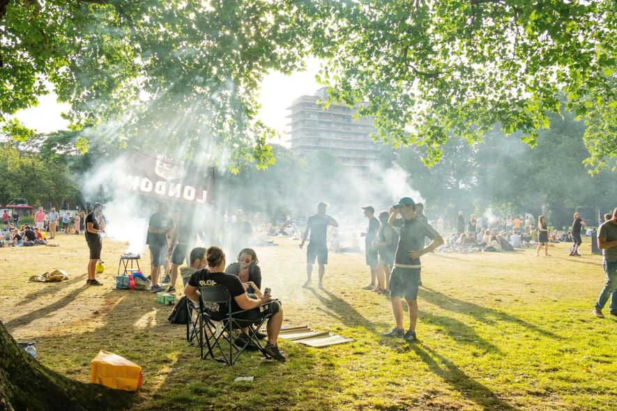 Parks and green space make up a third of the city. Revellers barbecue at London Fields ...