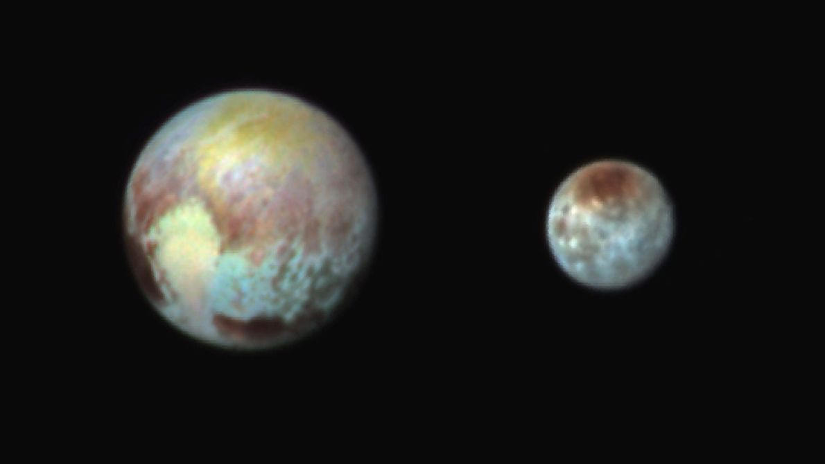 A false-colour image of Pluto and Charon exaggerates differences to make features easier to see. Filters ...
