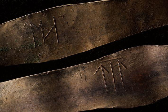 These two arm rings, inscribed with ancient runes, came from the upper layer of the hoard. ...