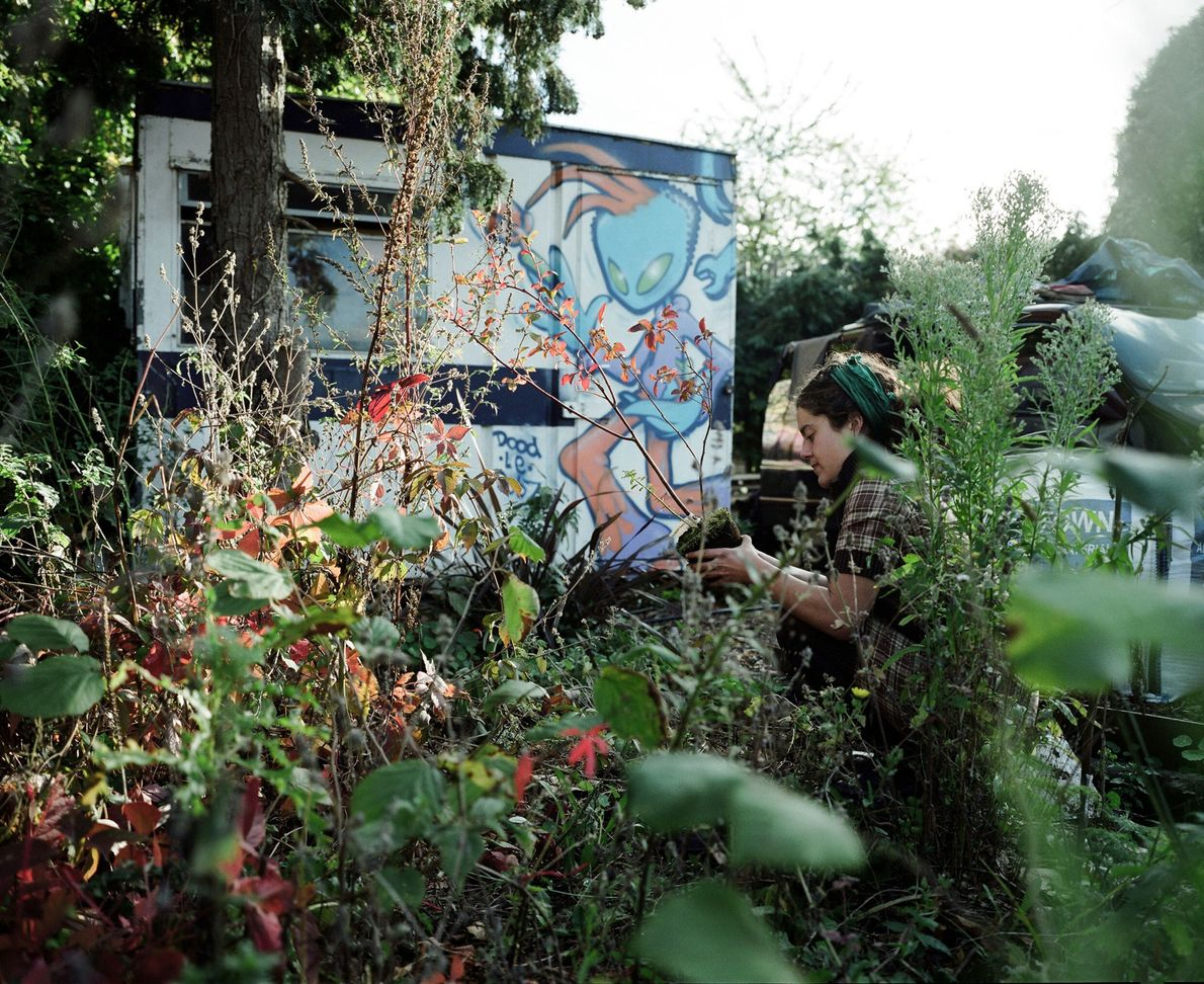 A Grow Heathrow resident tends to a garden. The community has made its home on the ...