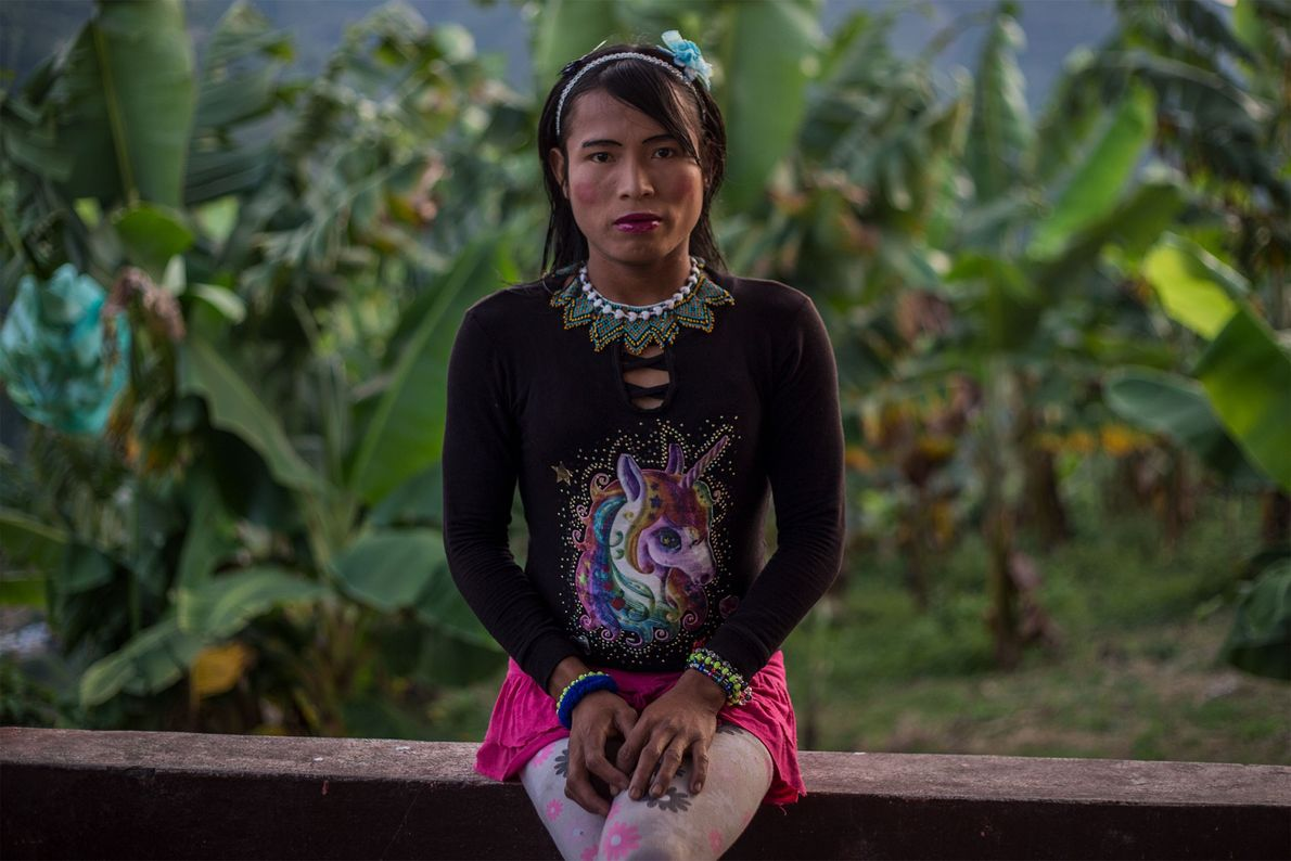 Francy, a member of the ethnic group Emberá Katio, sits on the balcony of the farm ...