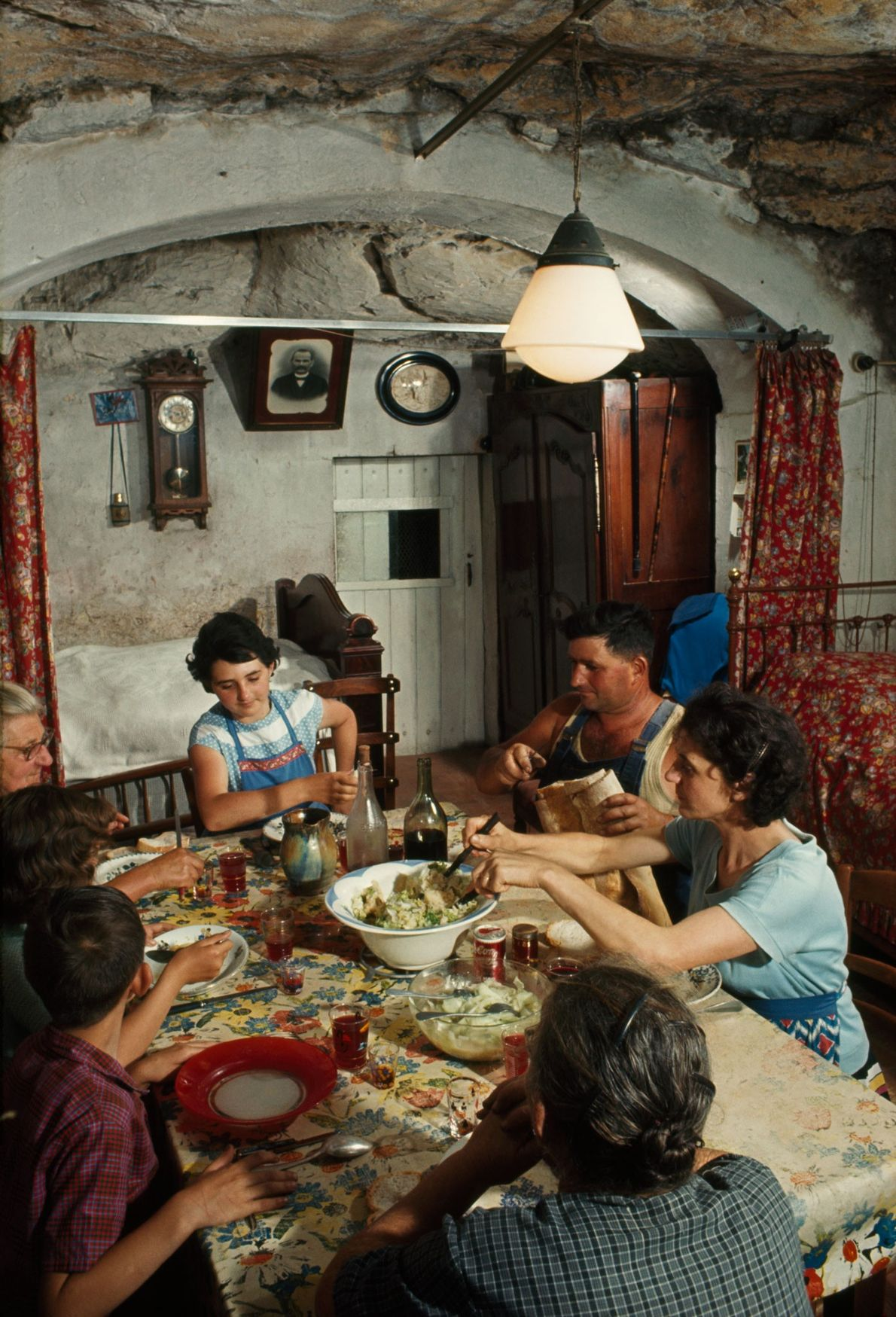 Family members eat lunch in their cavern home in the Loire region of France.
