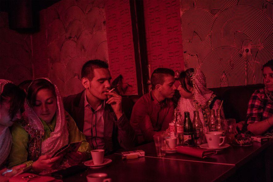 Before the houra dance at the wedding of Fatme Inuz and Feim Osmanov, teenagers smoke, flirt, ...