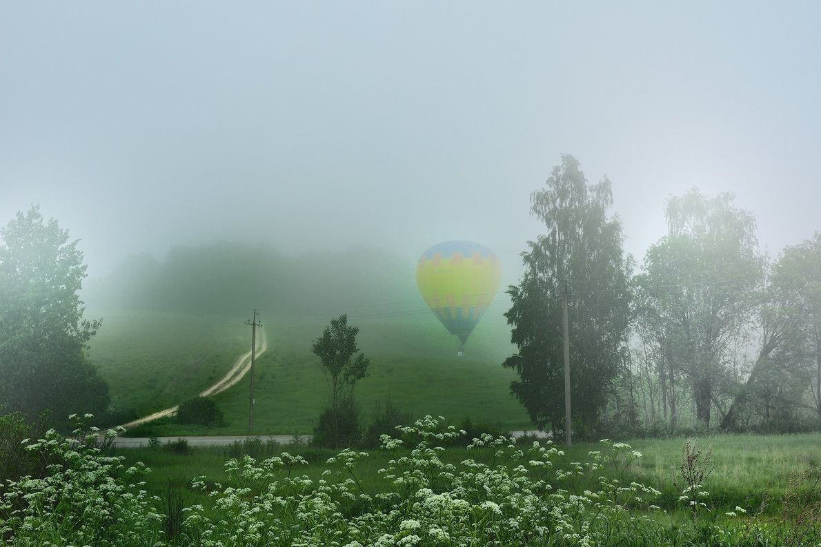 Your Shot photographer Anna Ivanova documented this foggy morning while a hot-air balloon prepares for take ...