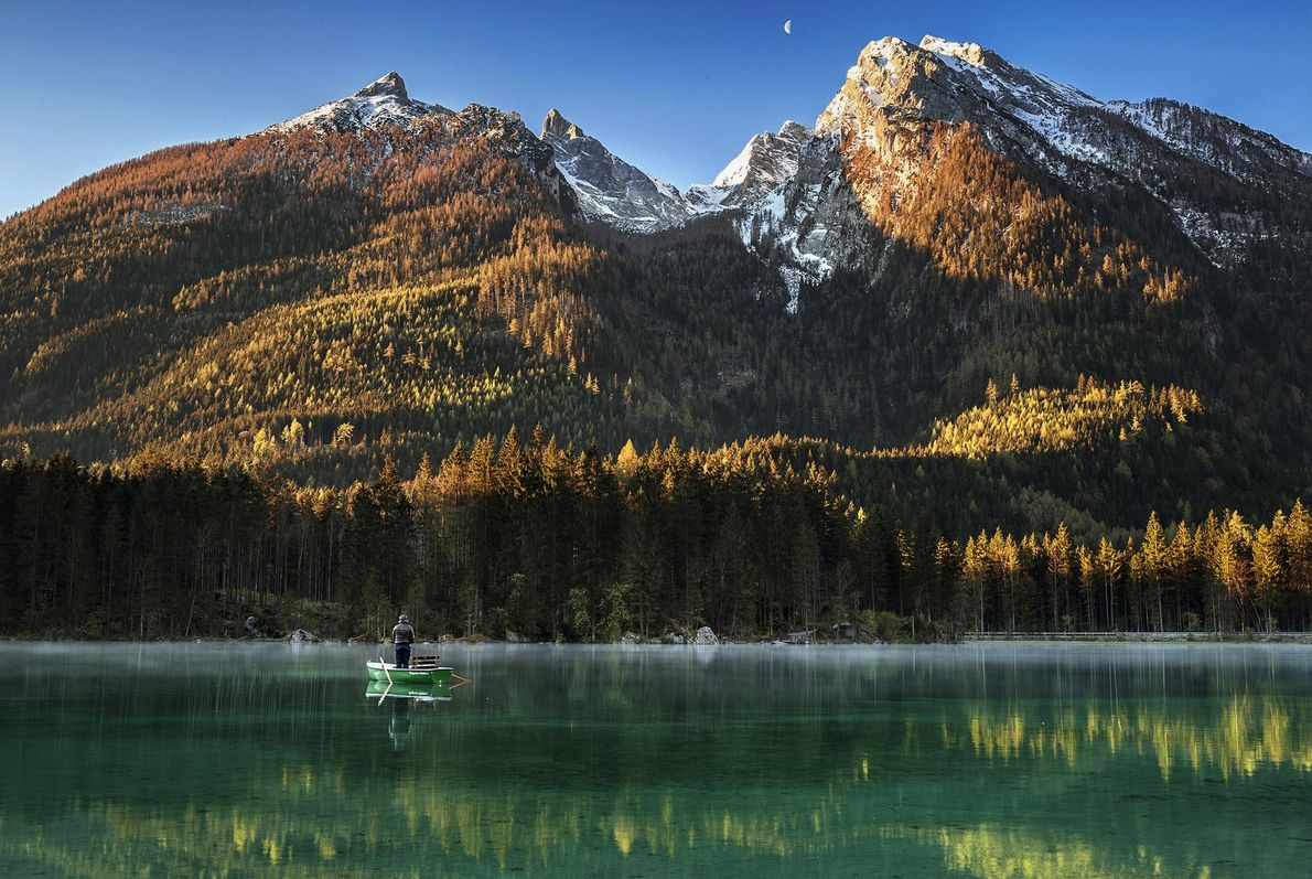 Your Shot photographer Lazar Ovidiu documented this ealr morning scene of a fisherman on Lake Hintersee ...