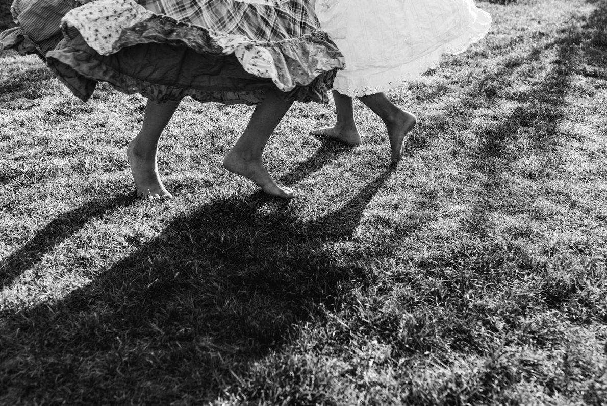 Your Shot photographer Joanna Milcarz documents her two girls dancing barefoot in the grass. She writes, ...