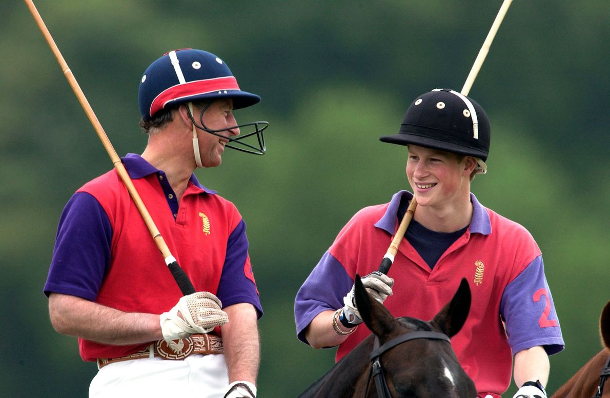 Prince Charles laughs with his 17-year-old son Prince Harry after winning their charity polo match at ...