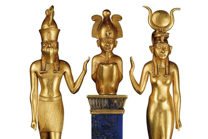 Isis (right), wearing a horned solar disc, and her son Horus gesture to the seated Osiris ...