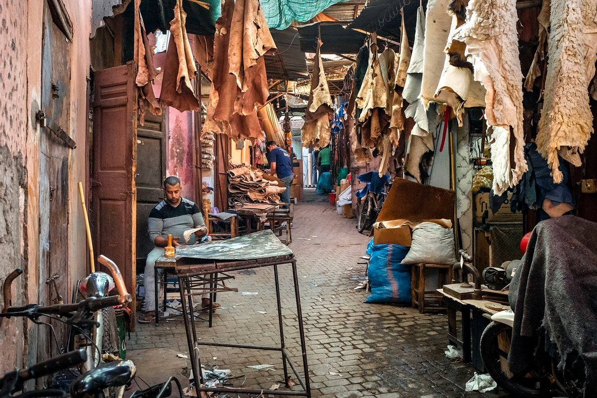 One of the main lanes of the artisans' quarter. Workers carry out their crafts inside and ...