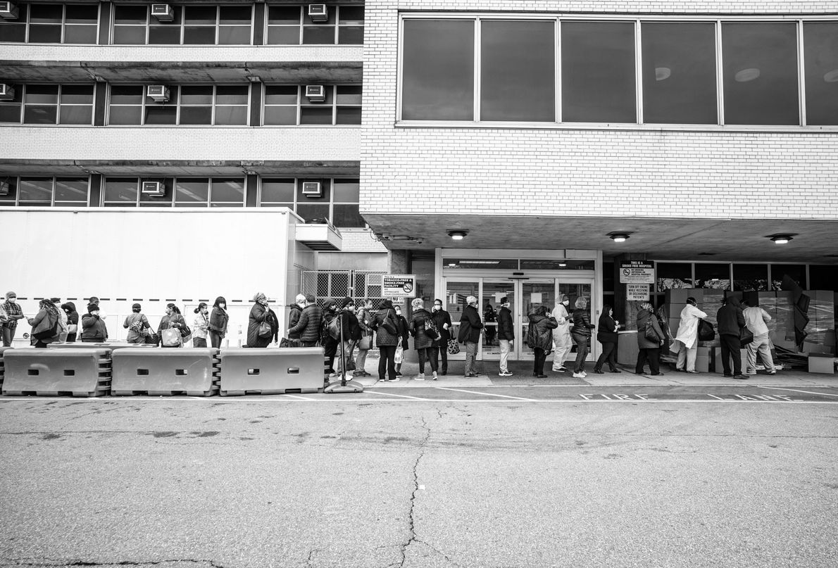 Workers at the Coney Island Hospital line up to recieve personal protective equipment before starting their ...