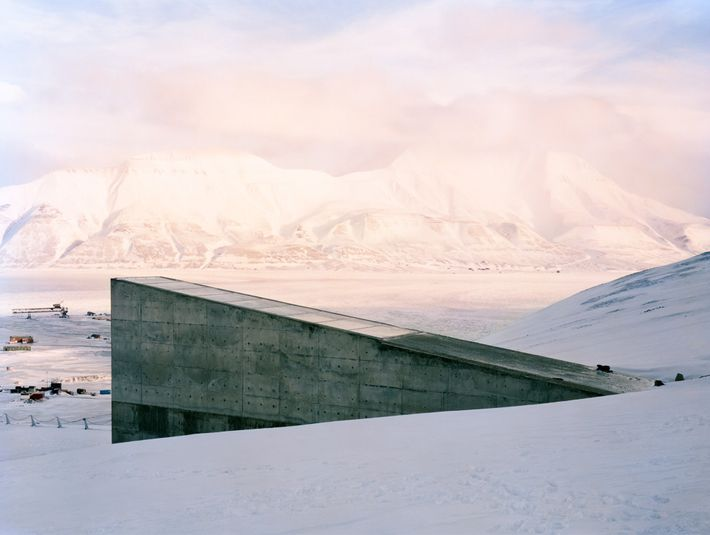 Snow blankets the land around the entry to the Svalbard Global Seed Vault on Spitsbergen Island, ...