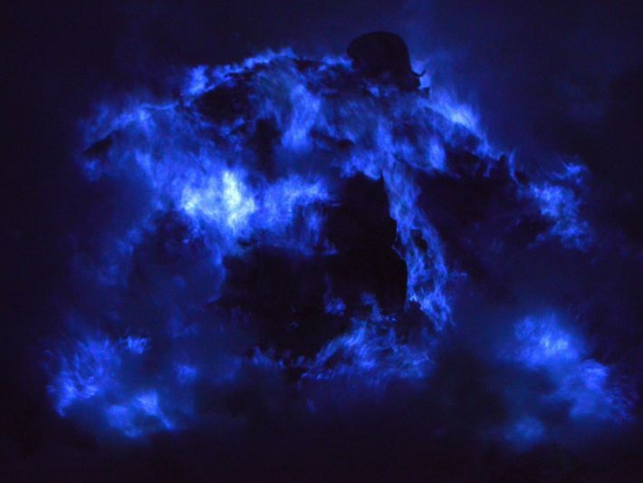 Sulphur combusts on contact with air to create stunning blue lava-like rivers of light in the ...