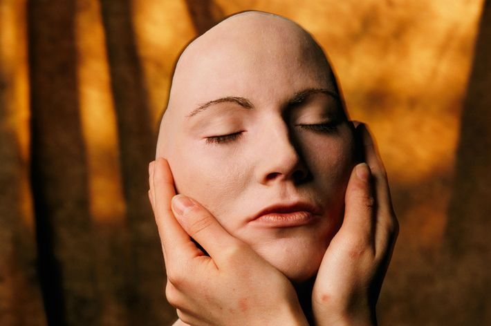 A British model holds a silicone mask of her face. Sarah Leen, who took this photo, ...