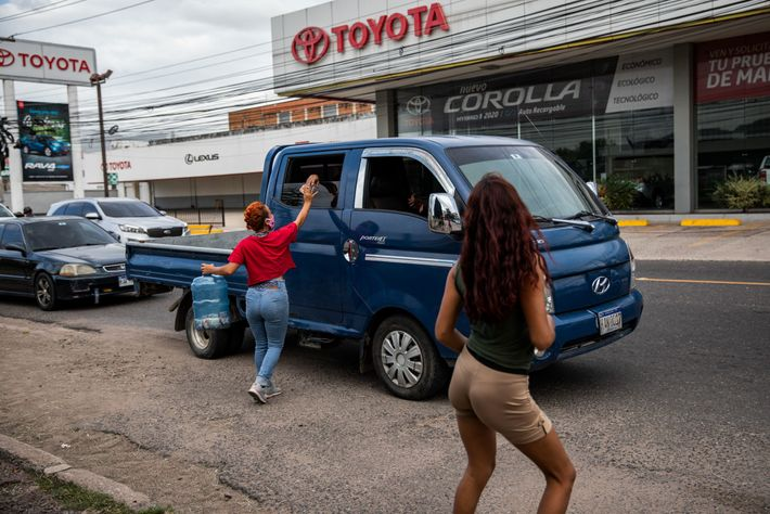 At a busy intersection in Tegucigalpa, Lilian accepts a donation from passing cars. After running out ...