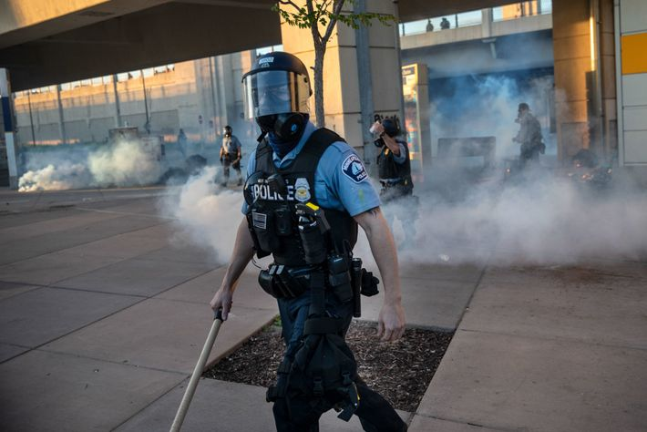 On Friday, a Minneapolis police officer dispersed people after tear gas and rubber bullets were fired ...
