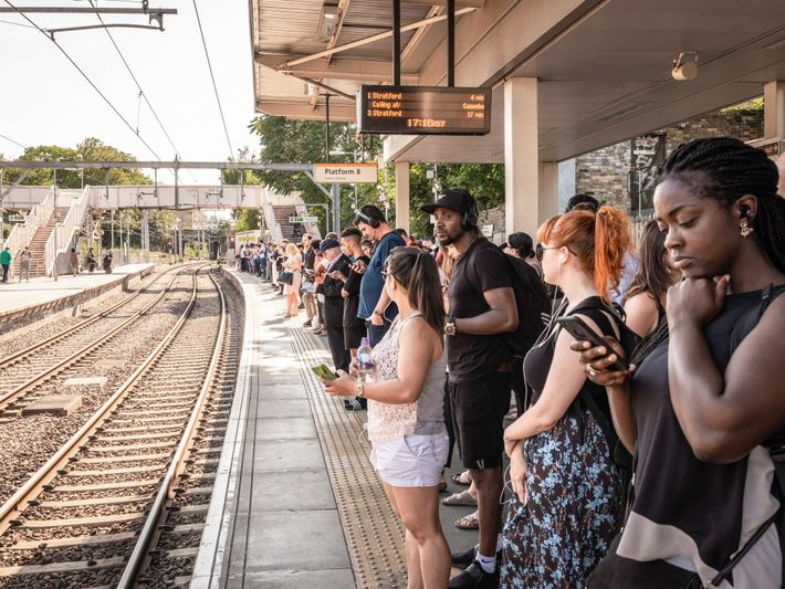 Passengers at the Highbury & Islington station wait for a London Overground train. The Overground network ...