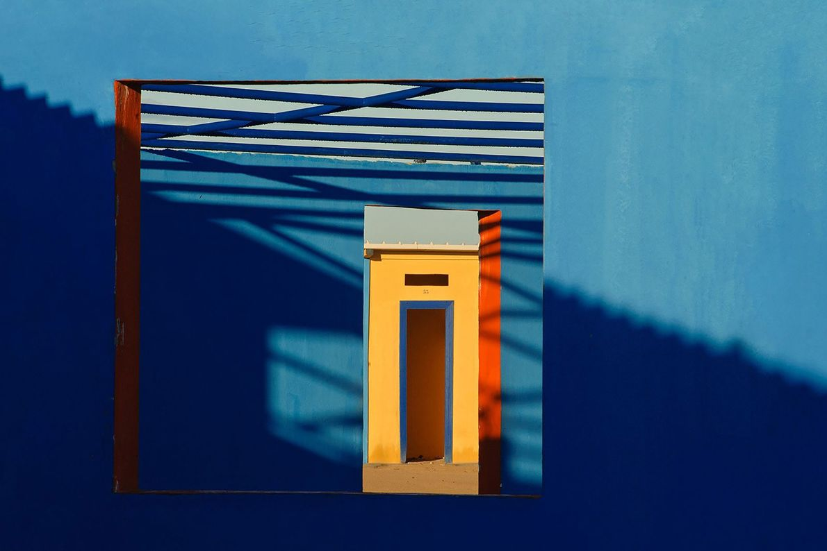 Primary colours peek through a window on an Italian beach. Bordered by the Adriatic and Ionian ...