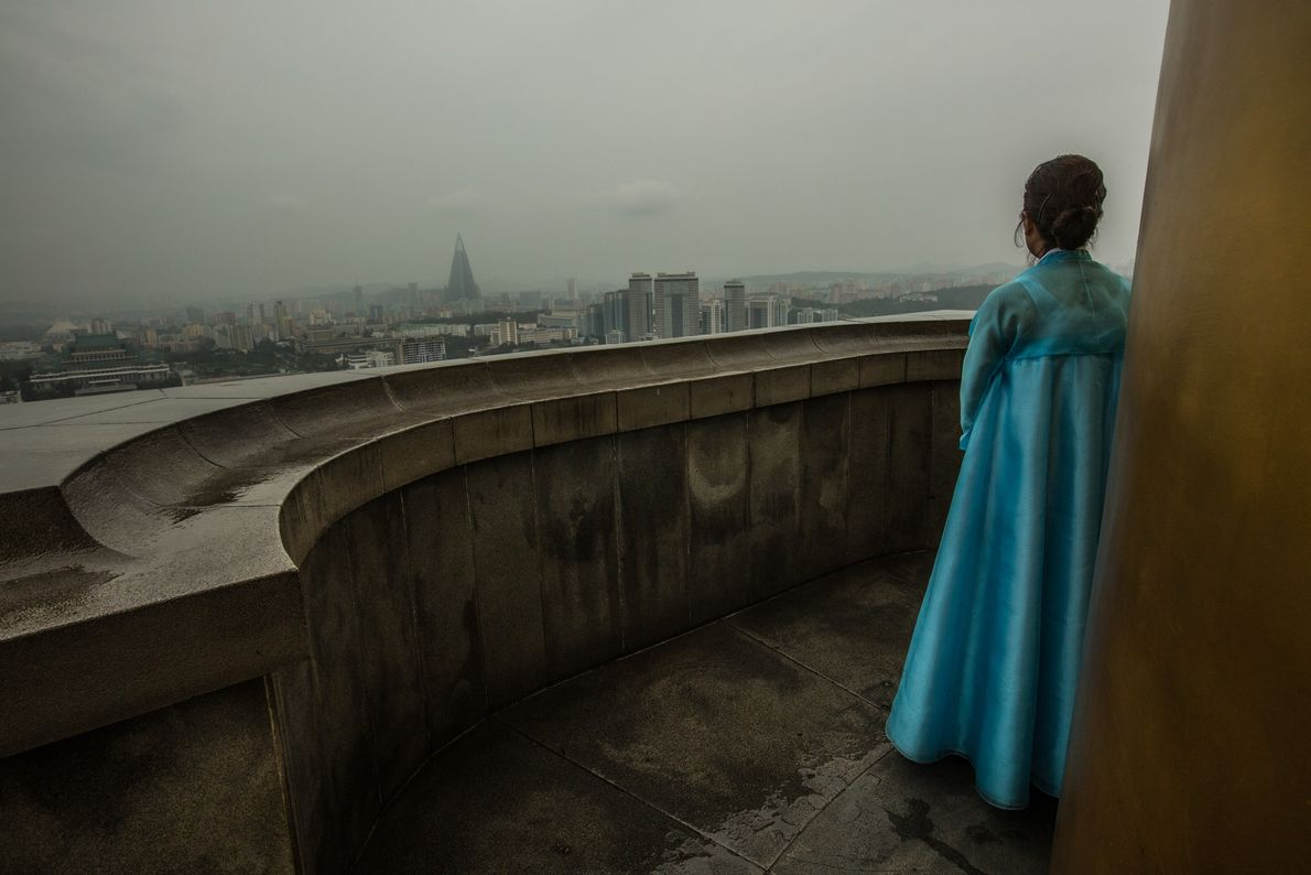 A guide looks out across Pyongyang from the top of Juche Tower.