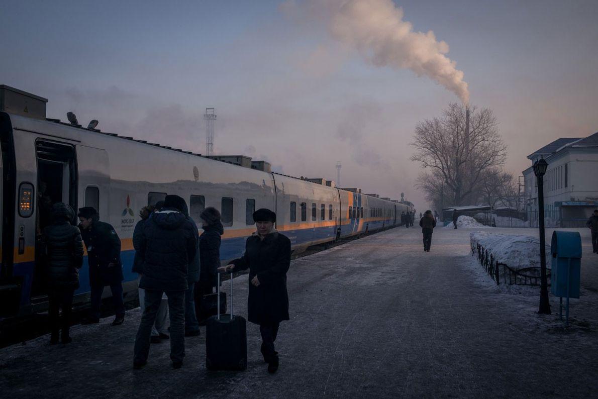 Passengers prepare to board the train in Semey.