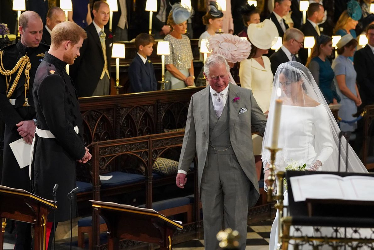 Prince Charles accompanies Prince Harry's bride-to-be Meghan Markle as she arrives at St George's Chapel for ...