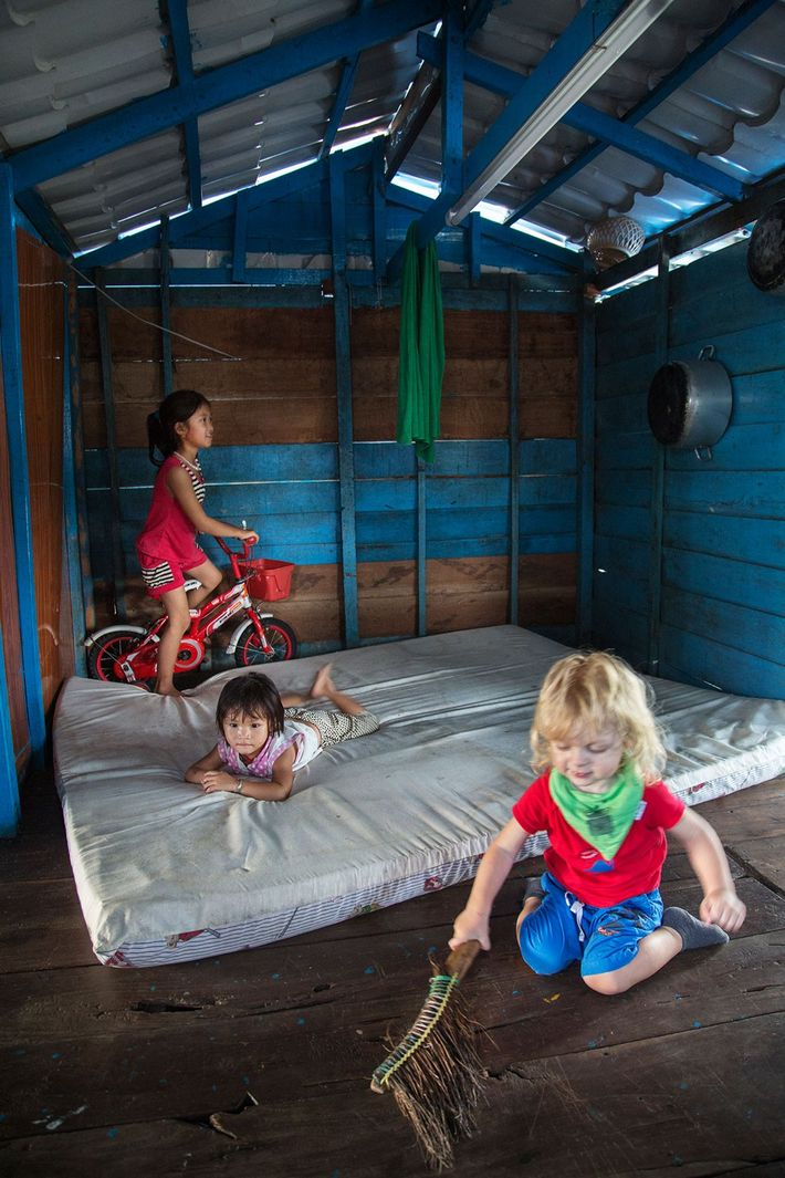 The photographer's son, Romeo, in a tiny home in Cambodia.