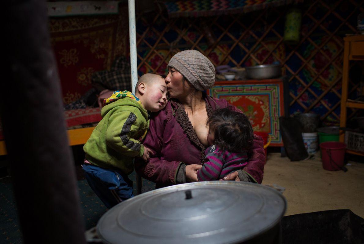 Enkhjargal tends to her children Bolo-Erdene and Ariunbold.  ...
