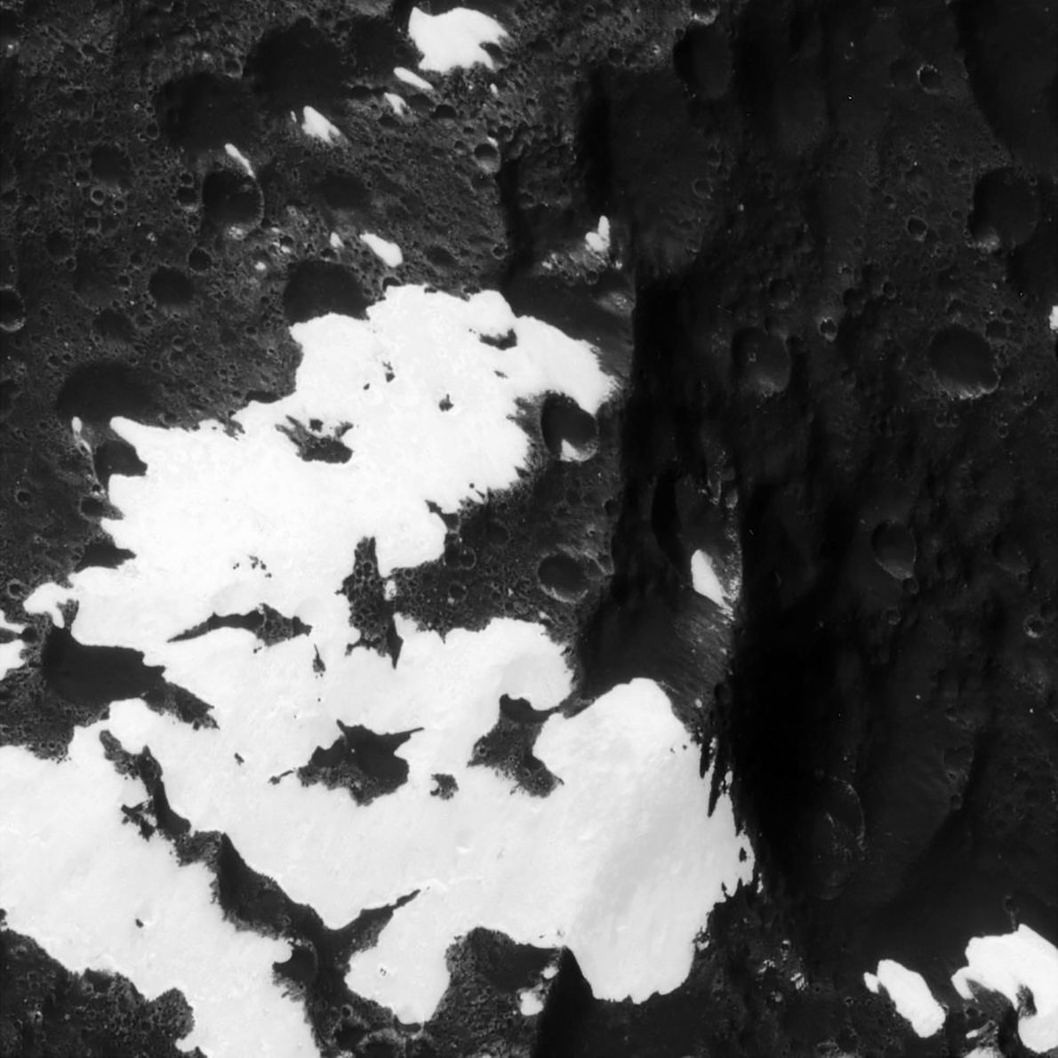 Cassini zooms in on patchy mountains on the moon Iapetus, originally identified in images from NASA's ...
