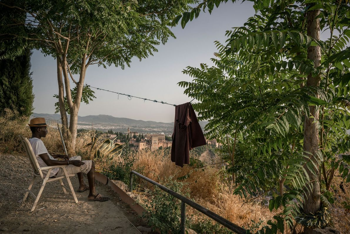 Sergine Mourtalla Mbacke, a Senegalese immigrant, looks out over the city of Granada and the Alhambra ...