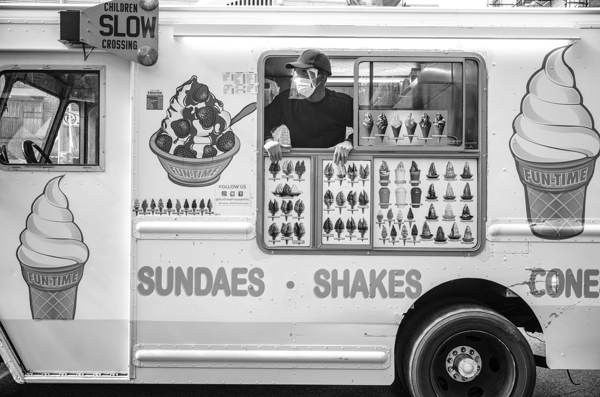 A Mr. Softie ice cream truck driver keeps an eye out for his usual customers on ...