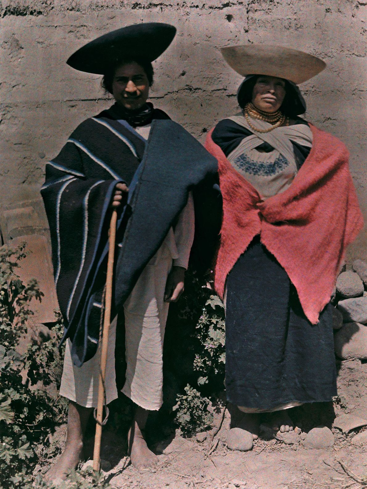 A man and woman from Otavalo, Ecuador, pose in bowl-shaped hats.