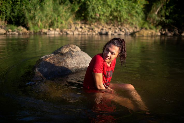 Alexa Smith, 20, from Honduras, spends an afternoon with friends at the river in Tapachula, on ...