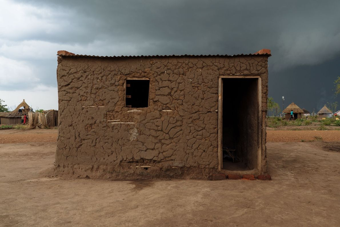 Clouds roll over a home built in a refugee settlement in Northern Uganda.