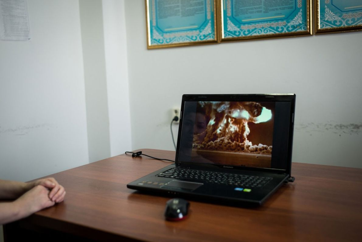 A staff member of the municipal government in Kurchatov shows a video about the nuclear testing ...