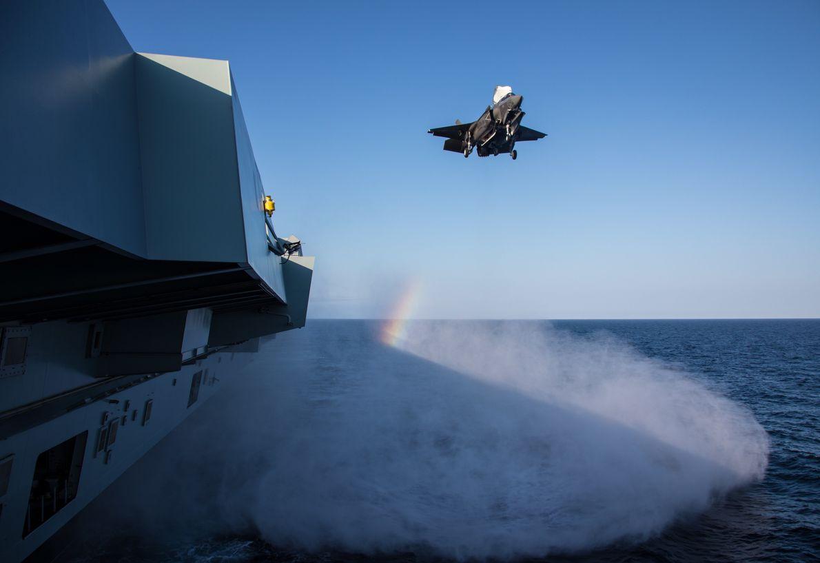 An F-35B Lightning II prepares to land on the flight deck of the HMS Queen Elizabeth ...